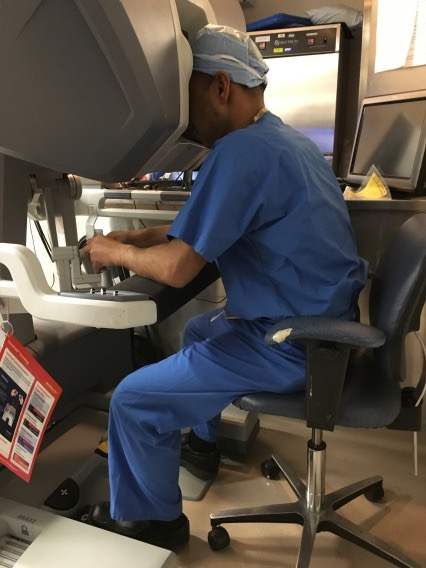 Dr. Mutahar Ahmed seated at the console performing a robotic prostatectomy
